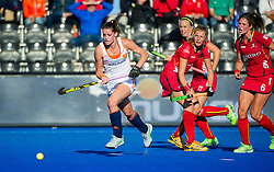 The Netherlands Lidewij Welten comes away with the ball after beating three Belgium players. The Netherlands v Belgium - Unibet EuroHockey Championships, Lee Valley Hockey & Tennis Centre, London, UK on 26 August 2015. Photo: Simon Parker