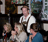 """Mike Webb (standing) during Mayhem & Mystery's production of """"Festival Fracas"""" at the Spaghetti Warehouse in downtown Dayton, Monday, September 27, 2010."""