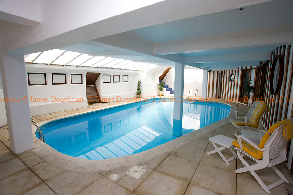 JAMES BOARDMAN / 07967642437<br /> Mrs Beryl Norris 's  swimming pool at her marine-side home in Hove, East Sussex. The 4 million pound property has a private beach, indoor swimming pool, Sauna, Jacuzz, 7 bedrooms, concealed bar and covered porch.