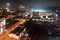 Night view onto Olimpiysky Stadium in Kyiv, Ukraine. Opereta Theatre is on the foreground. Cityscape at night.