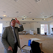 Troy City Schools Superintendent Lee Hicks talks about construction of the new Charles Henderson Middle School in Troy, Ala., Thursday, March 13, 2014. (Photo/Thomas Graning)