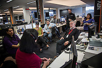 NITV National indigenous Television. News team discussion with chief of staff Michael Carey on the floor of NITV News.