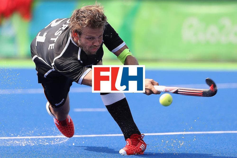 RIO DE JANEIRO, BRAZIL - AUGUST 09:  Moritz Furste #21 of Germany shoots the ball against Ireland during the hockey game on Day 4 of the Rio 2016 Olympic Games at the Olympic Hockey Centre on August 9, 2016 in Rio de Janeiro, Brazil.  (Photo by Christian Petersen/Getty Images)