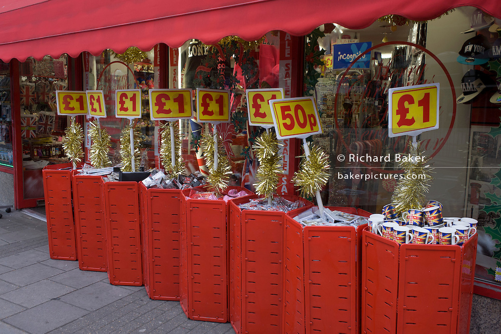 Tacky Christmas tourist trinkets on sale outside a discount shop in New Oxford Street in central London.