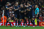 Nathaniel Clyne of Southampton (2nd right) celebrates scoring his team's second goal against Arsenal with team mates during the Capital One Cup match at the Emirates Stadium, London<br /> Picture by David Horn/Focus Images Ltd +44 7545 970036<br /> 23/09/2014