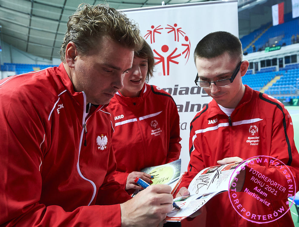 (L) Marcin Matkowski of Poland Special with Olympics athletes during second day the Davies Cup / Group I Europe / Africa 1st round tennis match between Poland and Lithuania at Orlen Arena on March 7, 2015 in Plock, Poland<br />