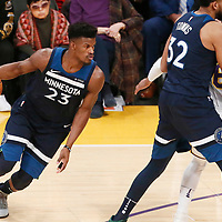 25 December 2017: Minnesota Timberwolves guard Jimmy Butler (23) drives past Los Angeles Lakers guard Jordan Clarkson (6) on a screen set by Minnesota Timberwolves center Karl-Anthony Towns (32) during the Minnesota Timberwolves 121-104 victory over the LA Lakers, at the Staples Center, Los Angeles, California, USA.