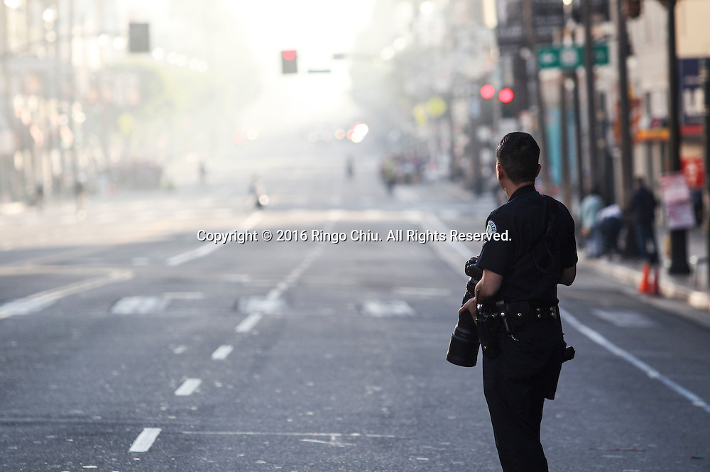 A police officer with a camera stands along Hollywood Boulevard during the 31st Los Angeles Marathon in Los Angeles, Sunday, Feb. 14, 2016. The 26.2-mile marathon started at Dodger Stadium and finished at Santa Monica.  (Photo by Ringo Chiu/PHOTOFORMULA.com)<br /> <br /> Usage Notes: This content is intended for editorial use only. For other uses, additional clearances may be required.