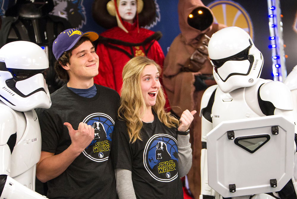 Mitch Goodmanson, 17, left, and Sally Kron, 18, pose with members of the 501st Legion Central Garrison at Star Wars night at the Timberwolves game at Target Center in Minneapolis December 15, 2015.