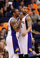 Apr 5, 2013; Phoenix, AZ, USA; Phoenix Suns forward P.J. Tucker (17) and forward Markieff Morris (11) talks on the court against the Golden State Warriors in the first half at US Airways Center. The Warriors defeated the Suns 111-107. Mandatory Credit: Jennifer Stewart-USA TODAY Sports