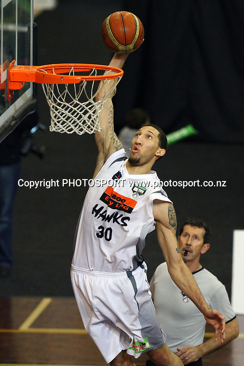 Hawks' Jon Rogers goes for the dunk. 2010 NBL Quarter Final, Harbour Heat v Hawke's Bay Hawks, North Shore Events Centre, Auckland. Wednesday 23rd June 2010. Photo: Anthony Au-Yeung/PHOTOSPORT