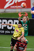 West Sydney's keeper Andrew Redmayne (Top) makes a save with Blake Powell (L) of the Phoenix and West Sydney's Scott Neville during the A-League - Wellington Phoenix v Western Sydney football match at Westpac Stadium in Wellington on Sunday the 10 April 2016. Copyright Photo by Marty Melville / www.Photosport.nz
