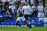 Clayton Donaldson and Richard Keogh tussle for the ball during the Sky Bet Championship match between Birmingham City and Derby County at St Andrews, Birmingham, England on 21 August 2015. Photo by Alan Franklin.