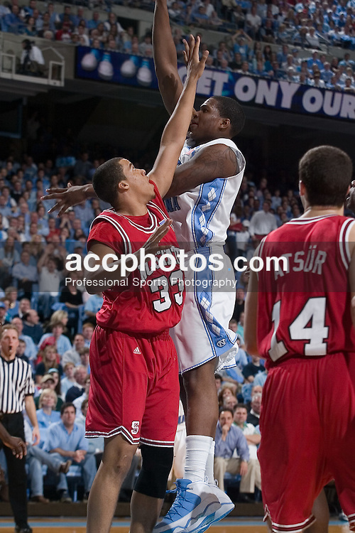 21 February 2007: North Carolina State Wolfpack forward Brandon Costner (33) tries to block North Carolina forward Deon Thompson (21) during a 83-64 to the North Carolina Tar Heels, in the Dean E. Smith Center in Chapel Hill, NC.