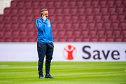 Kris Boyd (#9) of Kilmarnock FC on his mobile before the Ladbrokes Scottish Premiership match between Heart of Midlothian and Kilmarnock at Tynecastle Stadium, Gorgie, Scotland on 4 May 2019.