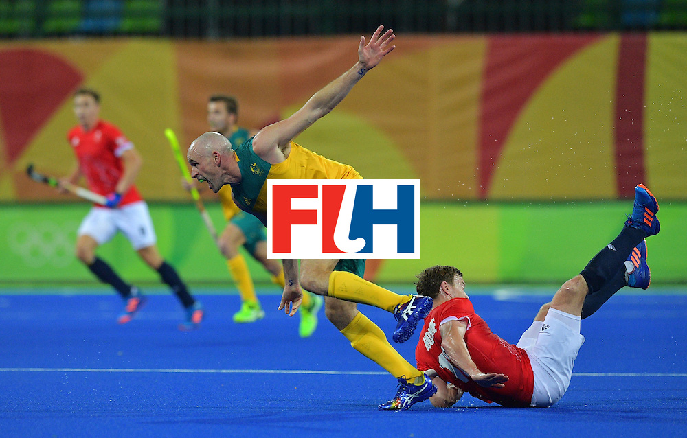 Australia's Glenn Turner runs over Britain's Michael Hoare during the men's field hockey Britain vs Australia match of the Rio 2016 Olympics Games at the Olympic Hockey Centre in Rio de Janeiro on August, 10 2016. / AFP / Carl DE SOUZA        (Photo credit should read CARL DE SOUZA/AFP/Getty Images)