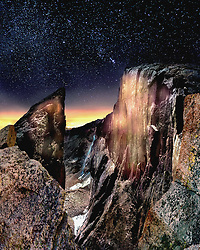 Midnight rules at Chasm View, not far from the summit of Longs Peak. Invisible by day, distant cities light the horizon like false dawns. You know it's summer by the cigarette glow of forest fires. It can be war and peace up here, with hurricane winds or wild lightning striking so quickly your ears ring. A confession, not so manly: in this very spot, I've pissed my pants more than once from terror.  Nietzche once said that What does not kill me makes me stronger. (Or was that Conan the Barbarian?) Stronger, I don't know. Wetter, yeah.<br />