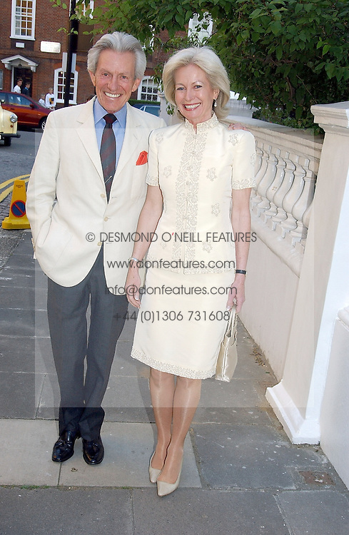 LADY ANNUNCIATA ASQUITH and the EARL OF LICHFIELD at Sir David & Lady Carina Frost's annual summer party held in Carlyle Square, London on 6th July 2004.