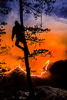 Local rock climber Mike Stam takes on a higher perspective of the Table Rock Fire from the west rim of the Linville Gorge. We're about one mile away as the crow flies from the fire and the sight and sounds of the fire mesmerized us for hours. The moonlight lit up the top of the smoke plume as the fire's glow  lit up the bottom part.