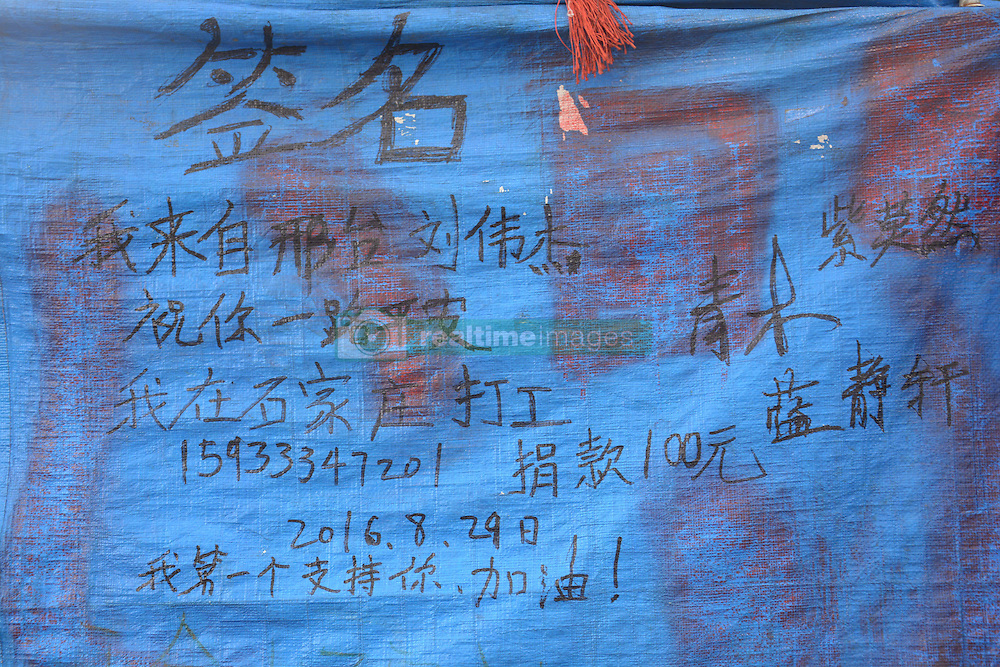 September 14, 2016 - Jinan, Jinan, China - Jinan, CHINA-September 11 2016: (EDITORIAL USE ONLY. CHINA OUT) The greetings and signatures of people who have met or helped Jin Donghe on his trip. Jin Donghe, a 36-year-old man, started his journey by the motorbike from Yanbian, northeast China¬°¬Øs Jilin Province, on May 18, 2016. He has traveled through about 3,400 kilometers by now, passing north China¬°¬Øs Liaoning, Tianjin, Beijing and Hebei. Jin spent no more than 2,000 yuan (about US$ 300) refitting the motorbike, equipping it with solar power equipment, television and sound box. He plans to travel around the country in three and a half years by motorbike. (Credit Image: © SIPA Asia via ZUMA Wire)
