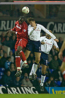 Photo. Jed Wee.<br /> Tottenham Hotspur v Middlesbrough, Carling Cup, White Hart Lane, London. 17/12/2003.<br /> Middlesbrough's Michael Ricketts (L) jumps with Spurs' goalscorer Darren Anderton.