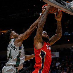 Dec 13, 2017; New Orleans, LA, USA; New Orleans Pelicans center DeMarcus Cousins (0) rebounds over Milwaukee Bucks forward Giannis Antetokounmpo (34) during the first quarter at the Smoothie King Center. Mandatory Credit: Derick E. Hingle-USA TODAY Sports
