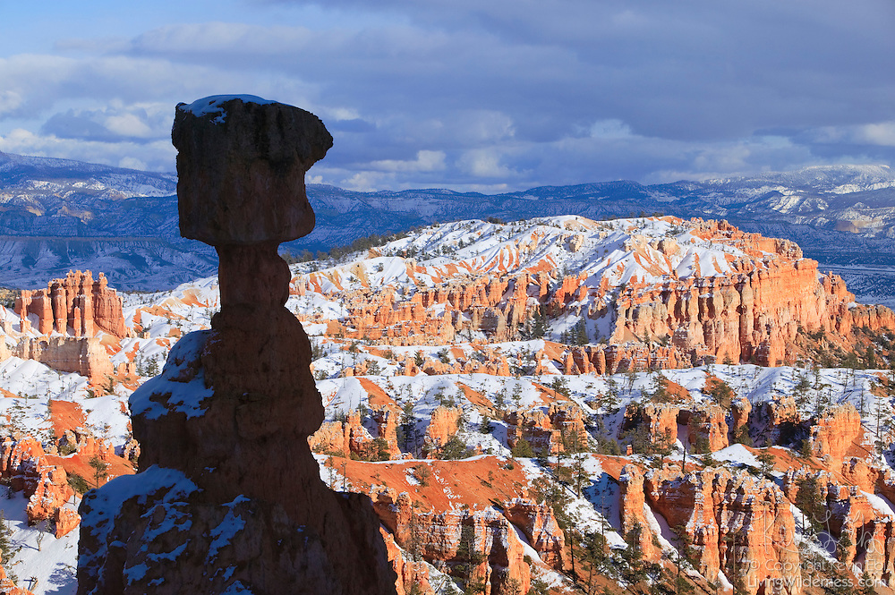 A prominent formation known as Thor's Hammer is rendered as silhouette against the Sinking Ship and other hoodoos in the Bryce Canyon amphitheter in Utah.