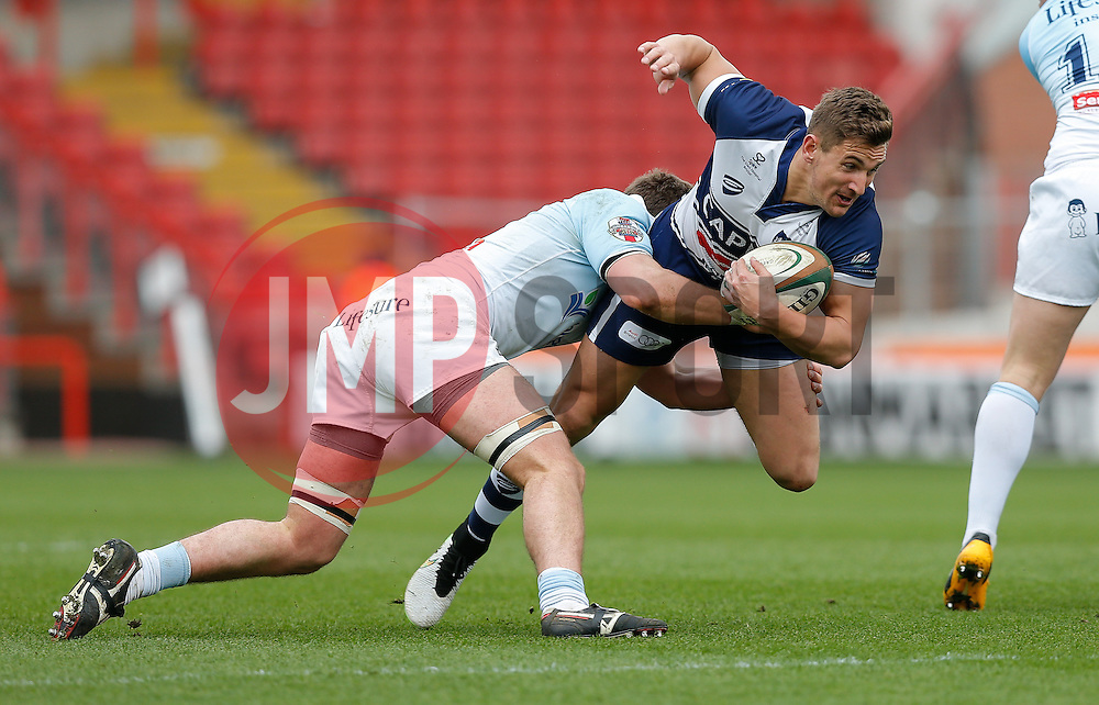 Bristol Rugby Winger George Watkins is tackled by Bedford Blues Flanker Josh Buggea - Photo mandatory by-line: Rogan Thomson/JMP - 07966 386802 - 29/03/2015 - SPORT - Rugby Union - Bristol, England - Ashton Gate Stadium - Bristol Rugby v Bedford Blues - Greene King IPA Championship.