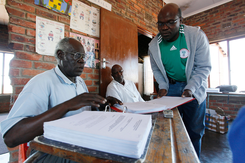 Legal Resources Centre researcher Shirhami Shrinda preparing court papers with the Sekuruwe community. <br /> <br /> Sekururwe is small community in Limpopo. They lost most of their agricultural land in 2005 when it was leased to a platinum mine. These photographs were taken as the community fought to get further compensation from the mine. They believe they were not fully involved in the consultation process or made aware of the affects the mine would bring to the economy of the village, their way of life, their ancestral graves and underground water.<br /> <br /> As a result of negotiations initiated by the Legal Resources Centre the mine made a substantial offer for financial compensation in 2011. South African law stipulates that consent must be gained before mining on communal land yet it is unclear how and whom this consent is gained from.<br /> <br /> &copy;Zute &amp; Demelza Lightfoot / Legal Resources Centre