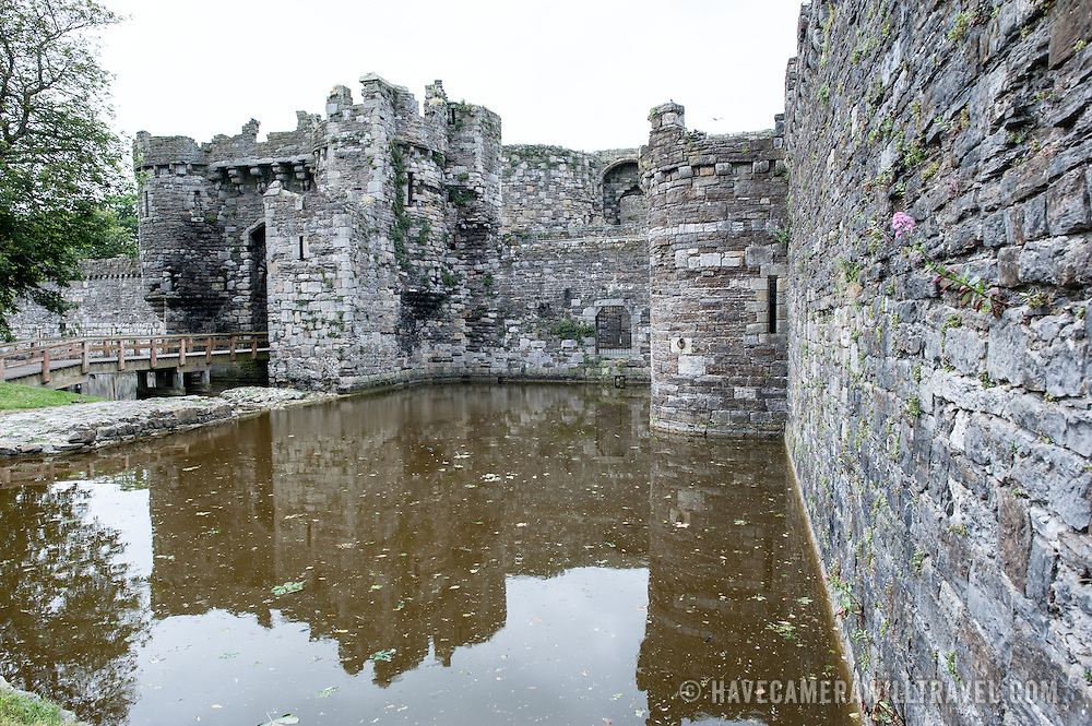 The moat and castle gate for Beaumaris Castle on the island of Anglesey of the north coast of Wales, UK. The castle dates back to the 13th century and is one of several commissioned by Edward I.