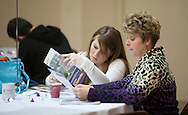Ali Schulte (from left), 18, and her mother, Susan Schulte, of Reno, NV look through a packet of materials during an open house at Waldorf College in Forest City, Iowa on Saturday, May 14, 2011.