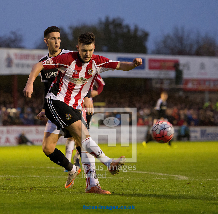 Sam Heathcote of Altrincham (nearest) hacks the ball clear during the FA Cup match at Moss Lane, Altrincham<br /> Picture by Russell Hart/Focus Images Ltd 07791 688 420<br /> 07/11/2015