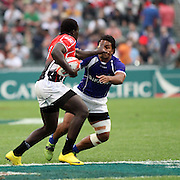 Manu's Afa Aiono takes a straightarm to the face, but stays with it to contribute to the tackle of Kenya's David Ambunya in the second half at Hong Kong Stadium, Hong Kong.  Photo by Barry Markowitz.