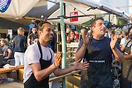 Nederland, Nijmegen, 20160715.<br /> Mobiele keuken &quot;Taste The Culture&quot; wordt mede gerund door Syrische vluchtelingen. <br /> De Kaaij. Cultureel Terras De Kaaij is een gratis festival aan de haven onder de Nijmeegse Waalbrug.<br /> Met veel eettentjes, oa.Gezellig op de Waal strandjes genieten van een drankje en een hapje onder het genot van optredens.<br /> <br /> Netherlands, Nijmegen<br /> The Kaaij. The Cultural Terrace Kaaij is a free festival at the port under the Nijmegen Waal bridge.<br /> With many food stalls, among others &quot;Taste The Culture&quot;, run by Syrian fugitives, and many performances. Relaxing on the Waal beaches to enjoy a drink and a snack while enjoying performances.