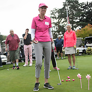 Judy Williams reacts after just missing the target in the Putt to Pigs Pail event during the annual Pink Ball Tournament in Charbonneau.<br /> Photo by Jaime Valdez