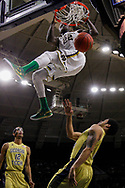 SOUTH BEND, IN - JANUARY 03: Jerian Grant #22 of the Notre Dame Fighting Irish dunks the ball over Tadric Jackson #1 of the Georgia Tech Yellow Jackets at Purcell Pavilion on January 3, 2015 in South Bend, Indiana. (Photo by Michael Hickey/Getty Images) *** Local Caption *** Jerian Grant; Tadric Jackson