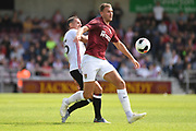 Northampton Town midfielder Harry Smith (8) battles for possession  with Sheffield United defender Phil Jagielka (15) during the Pre-Season Friendly match between Northampton Town and Sheffield United at the PTS Academy Stadium, Northampton, England on 20 July 2019.