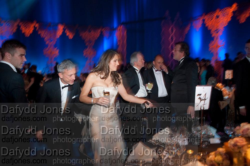PATRICK COX; ELIZABETH HURLEY; STEPHEN FRY, Grey Goose character and cocktails. The Elton John Aids Foundation Winter Ball. off Nine Elms Lane. London SW8. 30 October 2010. -DO NOT ARCHIVE-© Copyright Photograph by Dafydd Jones. 248 Clapham Rd. London SW9 0PZ. Tel 0207 820 0771. www.dafjones.com.