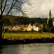 Steeple along river in Normandy region of France.