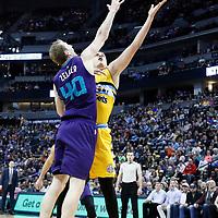 04 March 2017: Denver Nuggets forward Nikola Jokic (15) goes for the layup past Charlotte Hornets center Cody Zeller (40) during the Charlotte Hornets 112-102 victory over the Denver Nuggets, at the Pepsi Center, Denver, Colorado, USA.