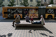 Bus passengers await the next service on Slovenska Cesta (street) in the Slovenian capital, Ljubljana, on 25th June 2018, in Ljubljana, Slovenia. Ljubljana city buses are operated by the Ljubljanski potniški promet (LPP) public utility company.