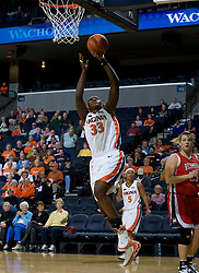 Virginia center Aisha Mohammed (33) goes up for a layup against Richmond.  The Virginia Cavaliers women's basketball team faced the Richmond Spiders at the John Paul Jones Arena in Charlottesville, VA on November 18, 2007.