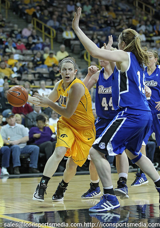 December 20, 2011: Iowa Hawkeyes guard Samantha Logic (22) passes the ball around Drake Bulldogs forward Rachael Hackbarth (15) during the NCAA women's basketball game between the Drake Bulldogs and the Iowa Hawkeyes at Carver-Hawkeye Arena in Iowa City, Iowa on Tuesday, December 20, 2011. Iowa defeated Drake 71-46.
