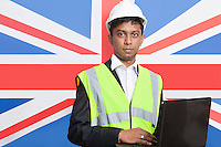Portrait of Asian architect in reflective vest using laptop against British flag