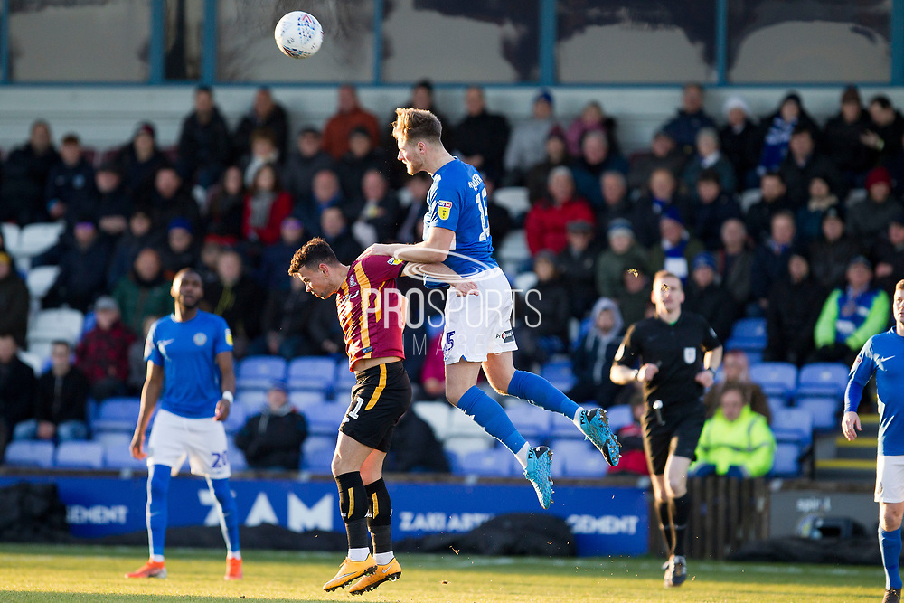 Macclesfield Town defender Fraser Horsfall in areal challenge with the opponent during the EFL Sky Bet League 2 match between Macclesfield Town and Bradford City at Moss Rose, Macclesfield, United Kingdom on 30 November 2019.