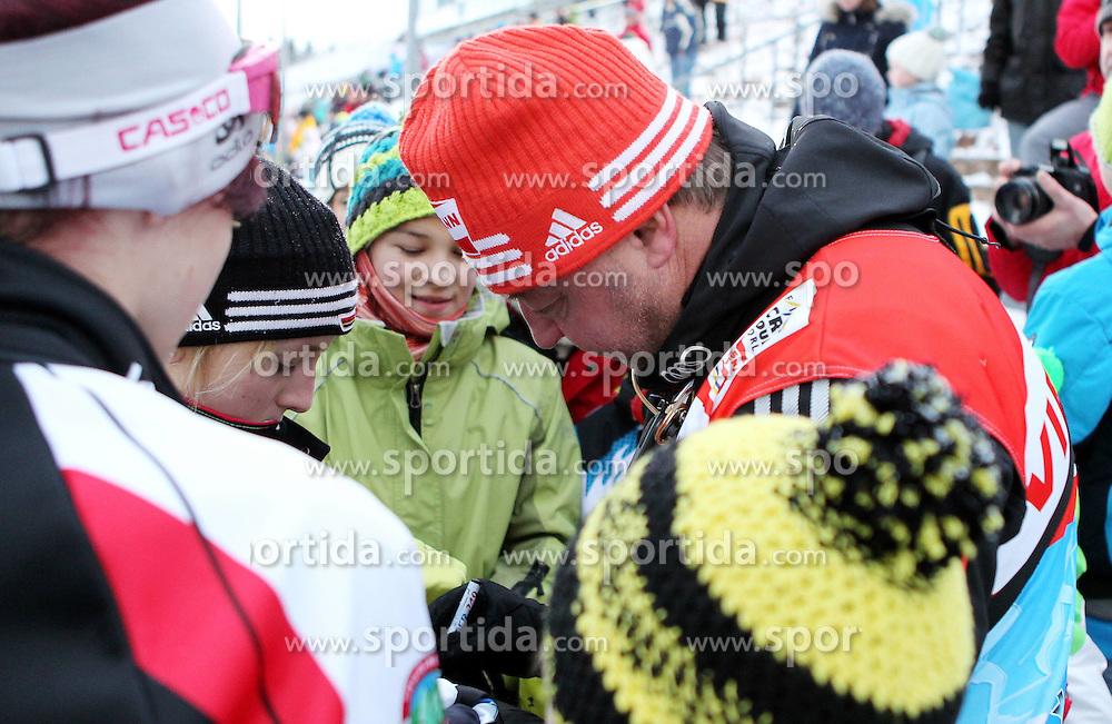 31.12.2011, DKB-Ski-ARENA, Oberhof, GER, Viessmann Tour de Ski 2011, FIS Langlauf Weltcup, Verfolgung Herren, im Bild Bundestrainer Jochen Behle (GER) gibt Fans Autogramme // during men's pursuitof Viessmann Tour de Ski 2011 FIS World Cup Cross Country at DKB-SKI-Arena Oberhof, Germany on 2011/12/31. EXPA Pictures © 2011, PhotoCredit: EXPA/ nph/ Hessland..***** ATTENTION - OUT OF GER, CRO *****