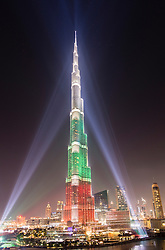 Evening view of Burj Khalifa skyscraper illuminated with national flag colours in Dubai United Arab Emirates