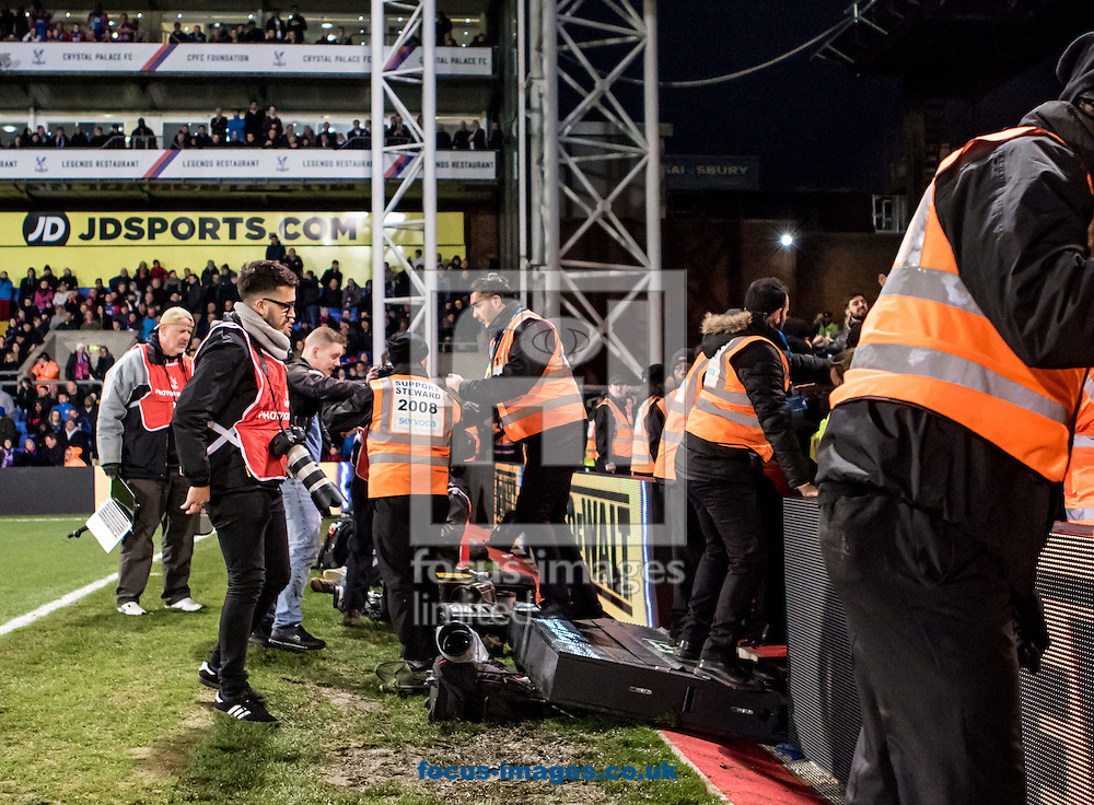 Photographers look on as the emergency boards crash down on to their equipment, after the Manchester City fans had entered the field of play during the Premier League match at Selhurst Park, London<br /> Picture by Liam McAvoy/Focus Images Ltd 07413 543156<br /> 19/11/2016