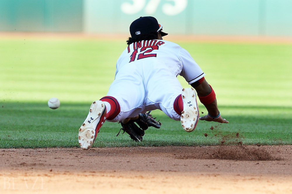 Sep 4, 2016; Cleveland, OH, USA; Cleveland Indians shortstop Francisco Lindor (12) makes a diving attempt at a ball hit by Miami Marlins shortstop Miguel Rojas (19) during the fifth inning at Progressive Field. Mandatory Credit: Ken Blaze-USA TODAY Sports