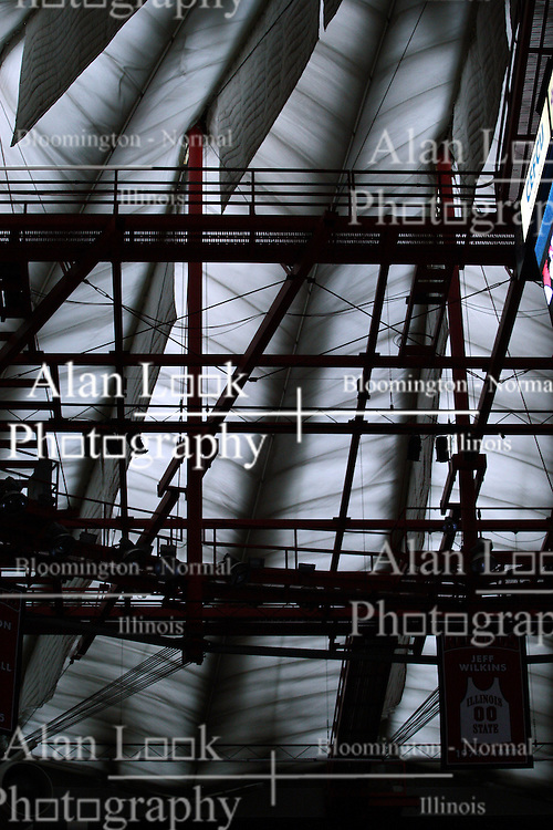 02 February 2013:  The fabric roof of Redbird Arena backlights the structure that holds it up and Jeff Wilkins retired jersey hangs below during an NCAA Missouri Valley Conference mens basketball game where the Salukis of Southern Illinois lost to the Illinois State Redbirds for Retro-Night 83-47 in Redbird Arena, Normal IL